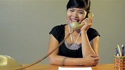 Young asian woman answering the phone, getting mad and angry, and hanging up - tracking shot.
