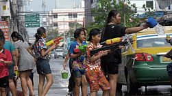 Bangkok, Thailand - April 14, 2014: Water fight on the side of a road during the Songkran Festival in Thailand.