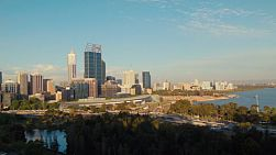 Shadows creeping across the view of the Perth City CBD in the late afternoon on a clear spring day.