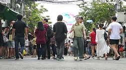 Crowds of Thai and foreign shoppers enjoy hanging out at Chatuchak weekend market in Bangkok, Thailand.