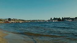 Late afternoon on the Swan River in Perth, Australia, with boats at a yacht club in the background.