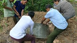 SVAY RIENG, CAMBODIA, JUNE 2018: A group of young people on a short-term missions trip build a new bathroom for an elderly lady in rural Cambodia.