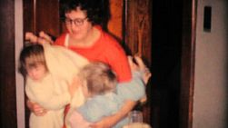 Sleeping little sisters check out new Christmas presents in the living room in 1961.