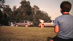A man experiments with throwing a curve ball pitch to his young nephew during the summer of 1982.