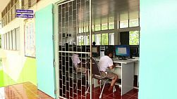 BURIRAM, THAILAND, SEPTEMBER 2013: A group of Asian students work in a computer lab at school in Buriram, Thailand.
