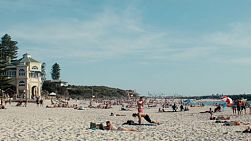 Friends sunbathing and enjoying a hot day at Cottesloe Beach in Western Australia.