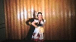 A beautiful teenage girl performs her Ukrainian dance for her recital.