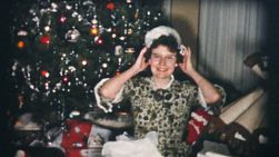 A pretty teenage girl finally gets her fuzzy white hat on Christmas Day in 1958 and she loves it!