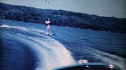 A teenage girl enjoys waterskiing on the lake during the summer of 1962.