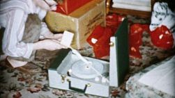 A teenage boy gets a brand new record player on Christmas morning in Cleveland, Ohio in 1956.
