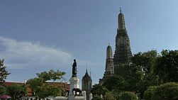 A lovely left to right pan shot of Bangkok, Thailand's Temple of the Dawn or Wat Arun, along the banks of the Chao Phraya river.