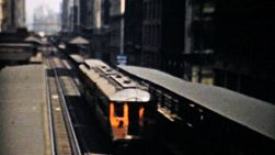 A shot of the famous L train as it winds through a downtown section of Chicago in the 1940's.