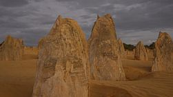 The pinnacles at dusk, with storm clouds brewing in the sky. The pinnacles are limestone formations contained within Nambung National Park, near the town of Cervantes, Western Australia.