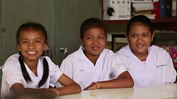 BURIRAM, THAILAND, SEPTEMBER 2013: Three beautiful Asian female students learning in the classroom in the rural town of Buriram, Thailand.