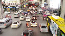 BANGKOK, THAILAND - NOVEMBER 8, 2013: Time lapse of a busy intersection by the Siam sky train station during rush hour, in Bangkok, Thailand. 4k & 1080p.