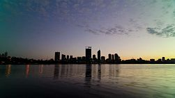 Time lapse of sunrise over Perth City skyline from across the Swan River.