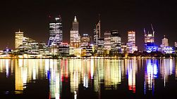 Time lapse of the lights of the Perth City skyline, reflecting off the Swan River at night.
