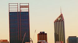 Skyscrapers in the Perth City skyline, with the light quickly fading as the sun sets.