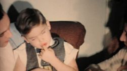 A tired little boy falls asleep at a family function and takes a swipe at his dad when woken up in 1962.