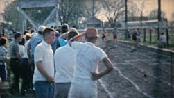 Young men participate in track and field events in the spring of 1962.