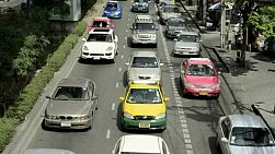 Traffic jam during rush hour on a busy road in Bangkok, Thailand.