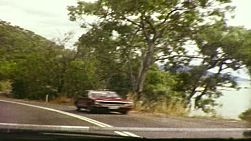 Vintage 8mm film footage of various road scenes on the highway from Cairns to Point Douglas, in Queensland, Australia in June 1983.