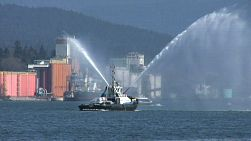 Tug Boat Spraying Water Backwards In The Harbor (HD 1080p30)
