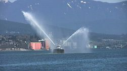 Tug Boat Spraying Water In The Harbor (HD 1080p30)