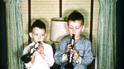 Two boys enjoy playing songs on their brand new clarinet's on Christmas morning in 1956.