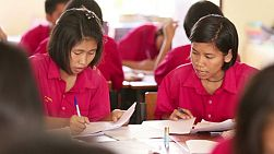 Two female Asian students studying together in school in Buriram, Thailand.
