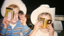 Two cute little cowboys goof around for the camera after getting gifts for Christmas in 1966.