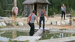 Two manly lumberjacks compete in the traditional log rolling competition.