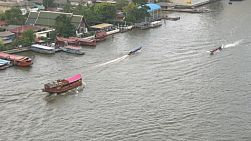 Various boats going up and down the Chaophraya River in Bangkok, Thailand.