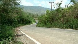 Several vehicle wind their way up a mountainous road outside of Chiang Mai, Thailand.
