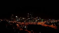 The lights of Perth City and the freeway at night, as seen from King's Park.