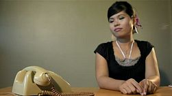 Vintage style set of a young Asian woman answering the phone - dolly shot.