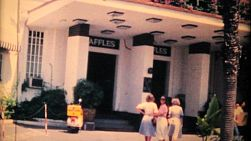 Tourists visiting the famous Raffles Hotel in Singapore while on vacation in 1970.