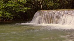 Water cascading down a small waterfall, part of the Huay Mae Khamin waterfalls in Kanchanaburi, Thailand.