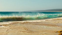 Small waves crashing onto a reef at Hamelin Bay in Australia's South West.
