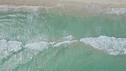 Aerial view of waves washing ashore on a windy day in Perth, Western Australia.