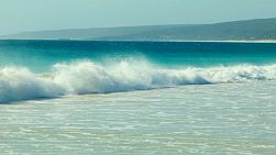 Beautiful small waves crashing on the beach at Hamelin Bay in Australia's South West.