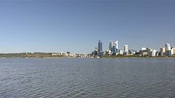 Wide angle view of Perth city from across the Swan River on a clear spring day.