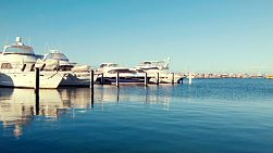 Rows of yachts and boats berthed in Fremantle Fishing Boat Harbour, near Perth, Western Australia.