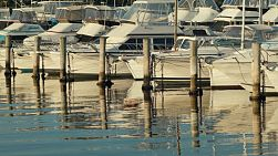 A row of yachts at a yacht club on the Swan River in Perth, Western Australia.