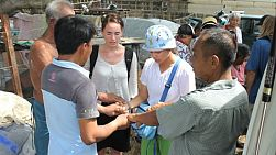A group of young adults on an overseas missions trip pray for people in the slums of Bangkok, Thailand.