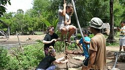 A group of young adults on a short-term overseas mission trip dig a new well for family in rural Cambodia.