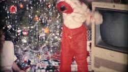 A young boy excitedly tries on his new pajamas on Christmas morning in Akron, Ohio in 1963.