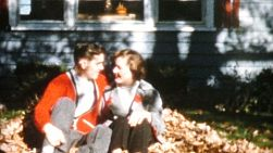 A young couple in love spend time mugging for the camera, playing together and throwing leaves at each other in the Fall of 1958.