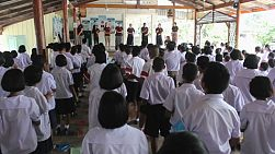 A short-term youth missions team teaches a fun action song to a class of Asian students in Ratchaburi, Thailand.