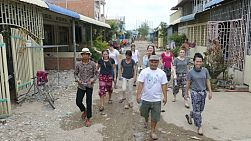 A group of young adults on an overseas missions trip spend time visiting Khmer families in the slums of Phnom Pehn, Cambodia.